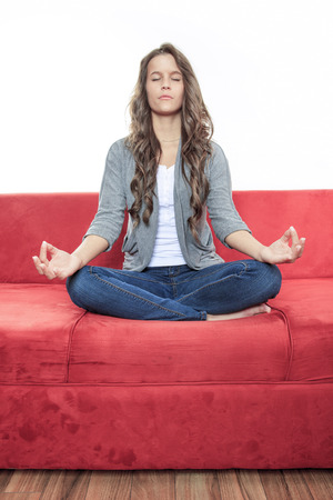 yoga pillows: Woman sitting in yoga pose. Young model. Healthy life.