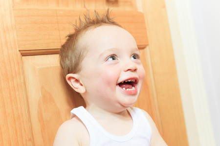 grinning: A happy 2 years old baby boy. Kid is smiling, grinning.