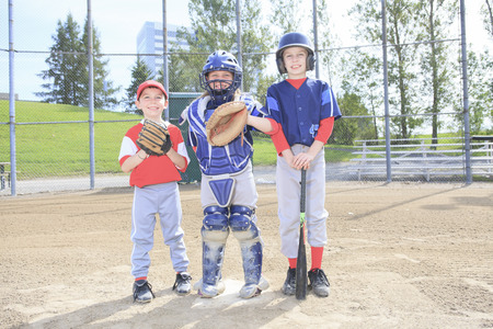 preadolescent: A baseball team of children play this sport Stock Photo