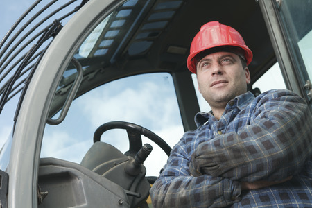 machinerie: A construction  men working outside close the is shovel Stock Photo
