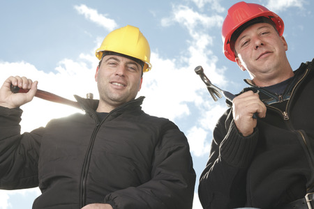 machinerie: Two construction worker men working outside with hammer. Stock Photo
