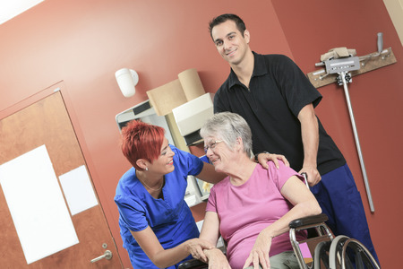 physiotherapists: An Elderly lady with her physiotherapists in a hospital