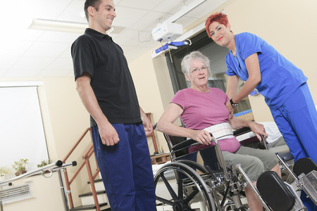An Elderly lady with her physiotherapists in a hospital
