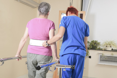 An Elderly lady with her physiotherapist in a hospital 스톡 콘텐츠
