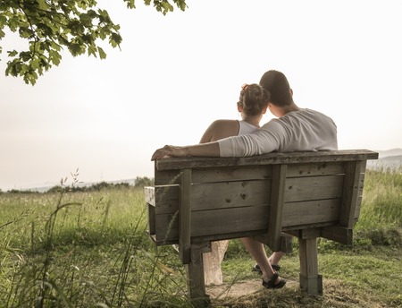 A Young couple in love outdoor at the sunset 免版税图像