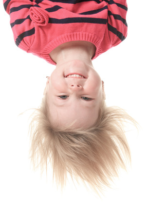 ittle: A ittle girl upside down wearing in pink white background Stock Photo
