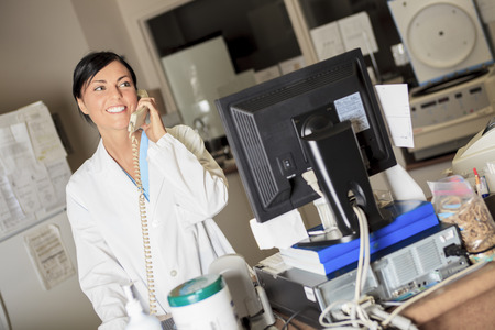 analytical chemistry: A scientist taling on the phone at work in a laboratory Stock Photo