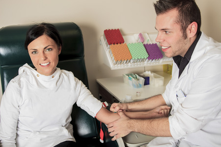 analytical chemistry: An employee maring a blood test in a laboratory.