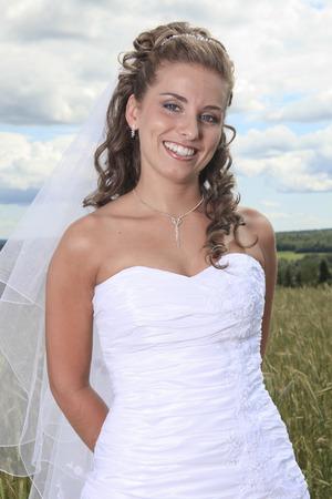 hay field: A portrait of bride near hay field