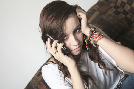 problem: A Anxiety Teenager  on the Phone having problem Stock Photo