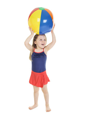 orthographic symbol: A little girl holding a beach ball