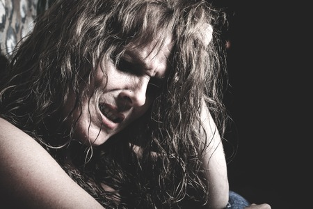 drug addict: A woman crying having a bad time in a tunnel