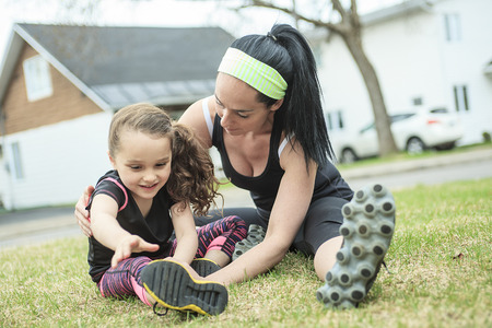 A Mother and daughter doing exercises together Imagens - 43357225