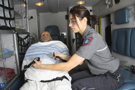 the unconscious: A professional paramedics giving unconscious men first aid