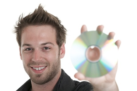 A men holding a cd or a dvd in studio white background