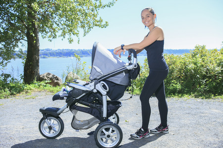 jogging: A Young mother jogging with a baby buggy