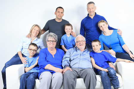family sofa: A family, happiness, generation and people sit on sofa Stock Photo