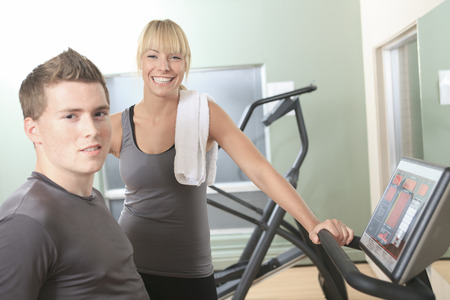 Two Young athletic couple in gym on training