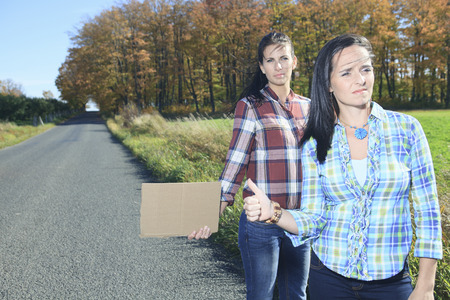 hitch: Two Womans asking for a hitch hicking on the road