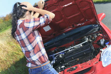 problem: A woman having a car problem on the side of the road Stock Photo