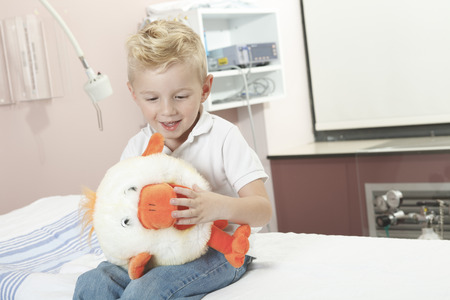 A Boy Relaxing in pediatric hospital with plush