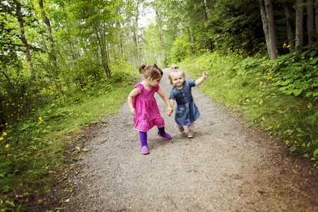 4s: Two cute little sisters having fun on a summer day