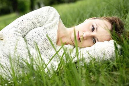 girl lying down: A beautiful girl lying down of grass