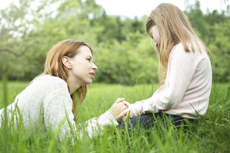 young child: A Mother and daughter in forest together Stock Photo