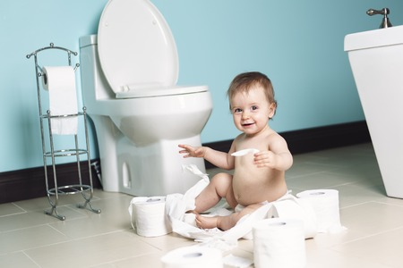 ornery: A Toddler ripping up with toilet paper in bathroom