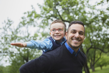 son: A Father and son in forest on a meadow Stock Photo