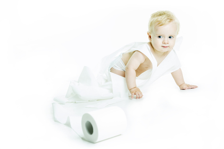 ornery: A Toddler ripping up toilet paper in bathroom studio