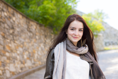 A Teenage girl with her handbag having fun