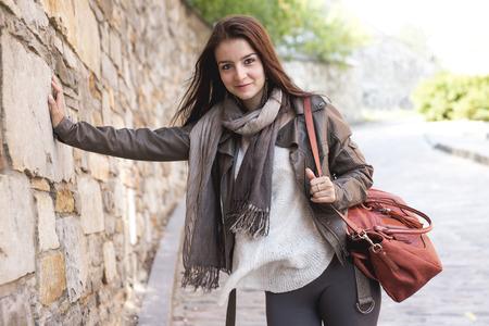 handbag: A Teenage girl with her handbag having fun