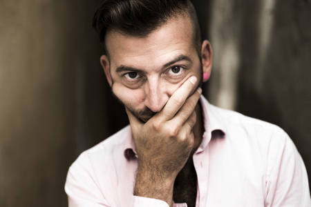 A Portrait of young, depressed man in pain Stock Photo