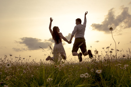 flowers sun: A Young couple in love outdoor at the sunset Stock Photo
