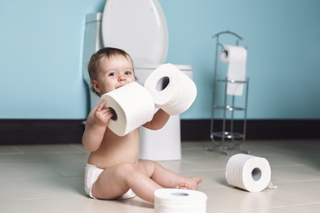 disobedience: A Toddler ripping up with toilet paper in bathroom
