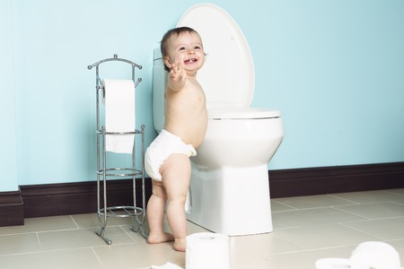 ornery: A Toddler in bathroom look at the toilet