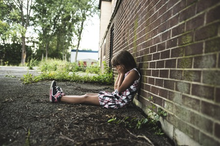 eight years old: A eight years old school girl close to the schoolyards