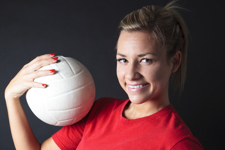 sportingly: young, beauty volleyball player. Isolated on black in studio