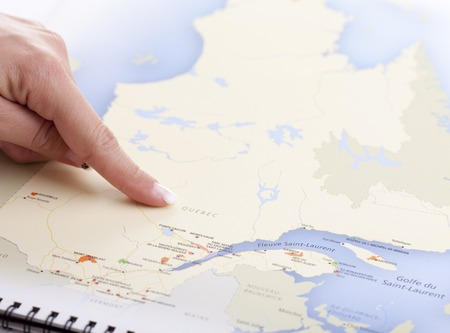 newfoundland: A hand who pointing Quebec on a MAP Stock Photo