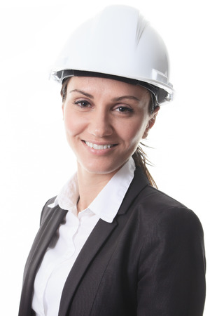 building sector: An Attractive architect holding blueprints and wearing helmet. All on white background.