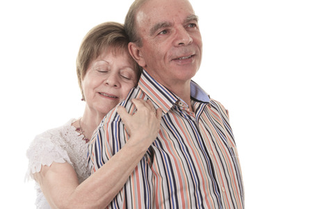 A Senior Couple Isolated on a white Background Stock Photo