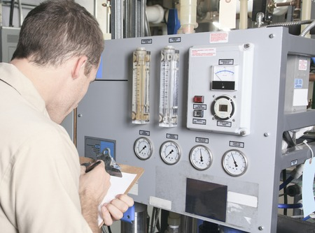 technicians: A Air Conditioner Repair Man at work Stock Photo