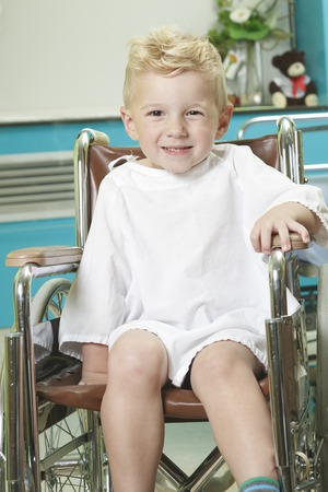 An adorable little boy in the wheelchair at the hospital Foto de archivo