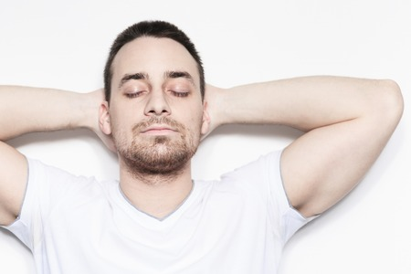 expressing: A relax man over a studio white background