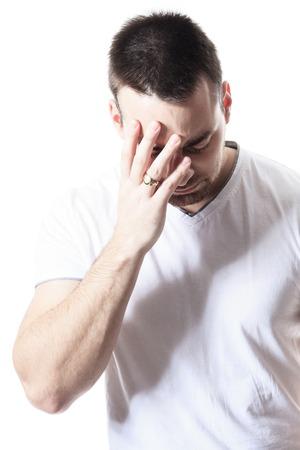 disturbing: A man having a disturbing problem over white