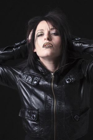 gothic woman: A gothic woman over a dark background,