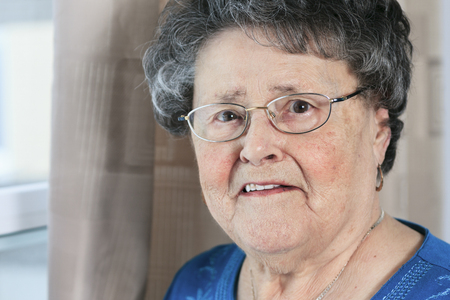 senior adult woman: A lonely 90 years old grandmother in is apartment