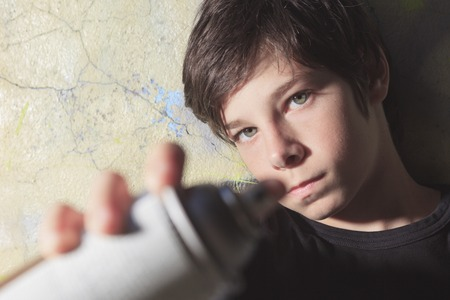 shaking out: A teen made some graffiti on the wall of a tunnel Stock Photo
