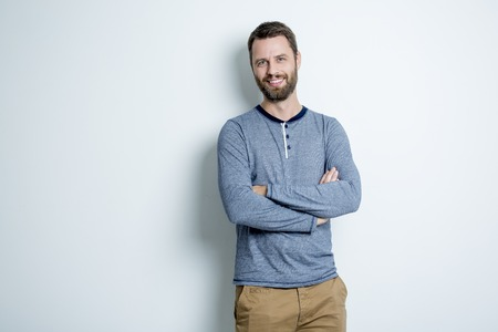A Portrait of a men in studio gray background Stock Photo